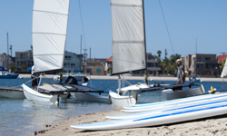 Mission Bay Aquatics Center sail boats and stand up paddleboards